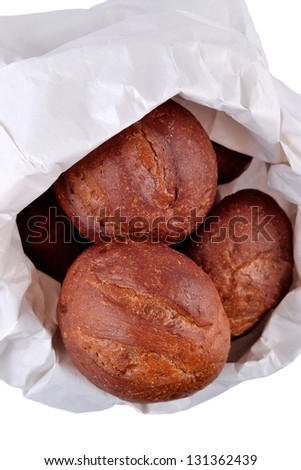 Fresh and delicious bread in a paper bag on a white background - stock photo
