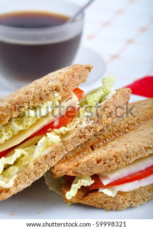 fresh and delicious classic club sandwich over a white glass dish with coffee - stock photo