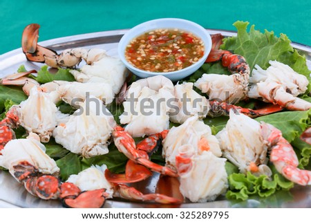 Fresh and delicious steamed or boiled crabs legs with spicy sauce, thai style, seafood - stock photo