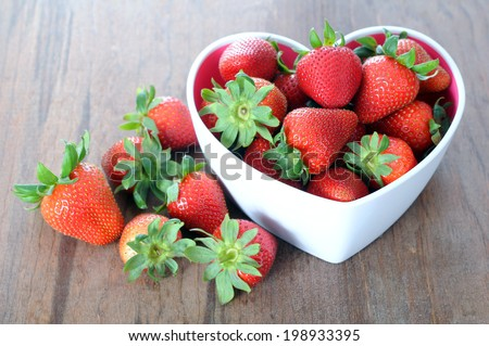 fresh and delicious strawberry on rustic table for Valentine Day - stock photo