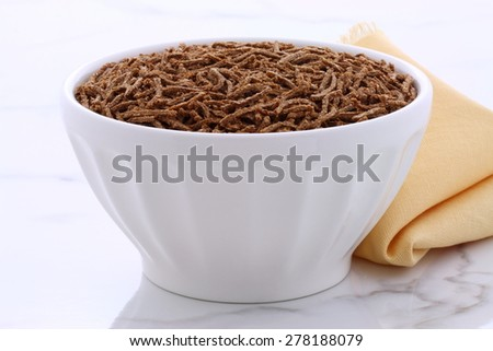 Fresh and delicious wheat bran cereal, on  vintage carrara marble. - stock photo