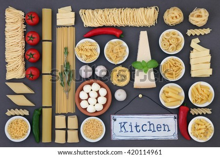 Fresh and dried italian food ingredient selection forming an abstract background over grey background. - stock photo