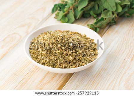 Fresh and dried oregano on wood  - stock photo