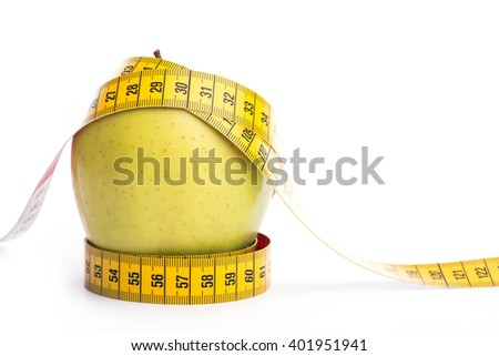 Fresh and green organic apple with metering tape over white background