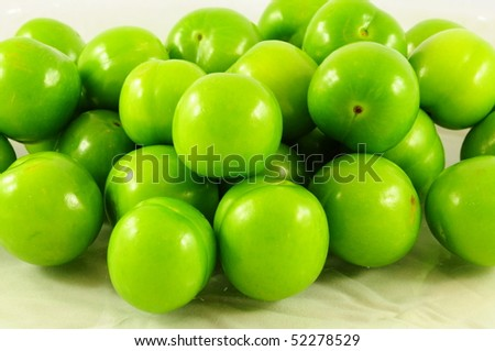 fresh and green plums - stock photo