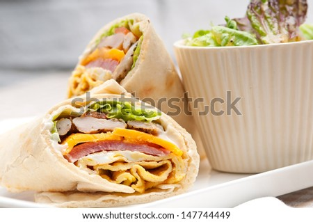 fresh and healthy club sandwich pita bread roll - stock photo