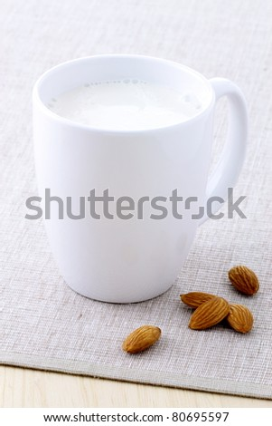 fresh and healthy cup of almonds milk made with organic soybeans