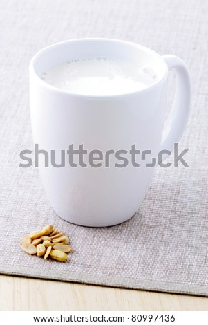 fresh and healthy cup of soy milk made with organic soybeans