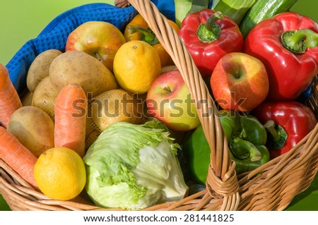 Fresh and healthy fruit and vegetables in a wicker basket  - stock photo