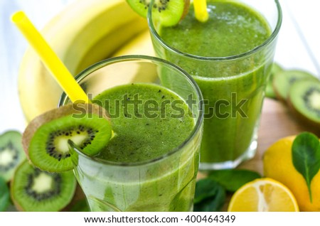 Fresh and healthy green smoothie  with spinach,banana, kiwi - stock photo