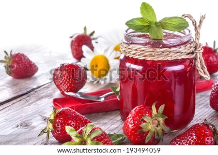 Fresh and healthy homemade strawberry jam on the table - stock photo