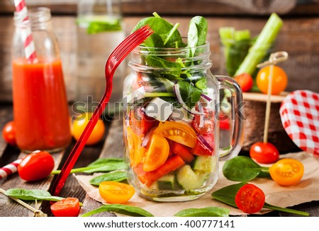 Fresh and healthy homemade vegetable salad in glass mason jar - stock photo