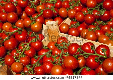 Fresh and healthy red tomatoes in a wooden box - stock photo