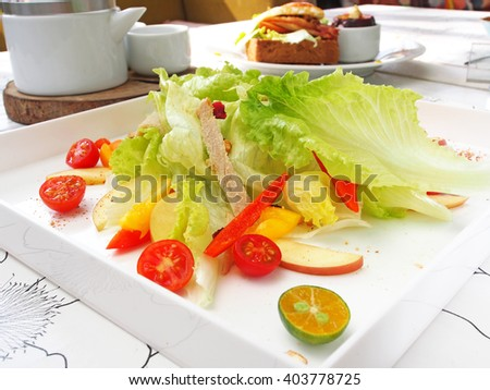 Fresh and healthy salad on white plate - stock photo