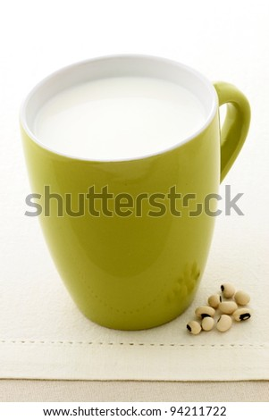fresh and healthy soy milk cup made with organic soybeans - stock photo