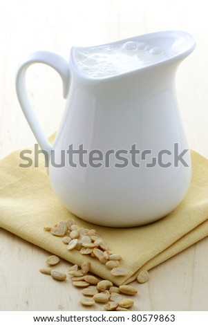 fresh and healthy soy milk jar made with organic soybeans - stock photo