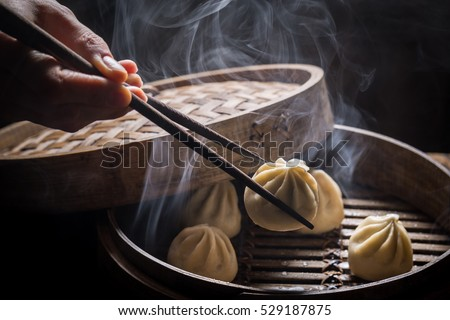 Fresh and hot manti dumplings in bamboo steamer