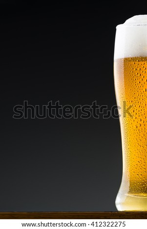 Fresh and ice cold beer in glass