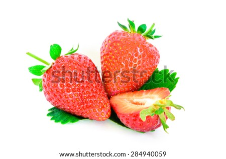Fresh and juicy ripe strawberries with leaves and slice cut. Isolated on a white background. They are organically grown in Puyallup, Washington State, USA.