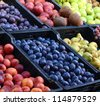 Fresh and organic fruits at farmers market - stock photo