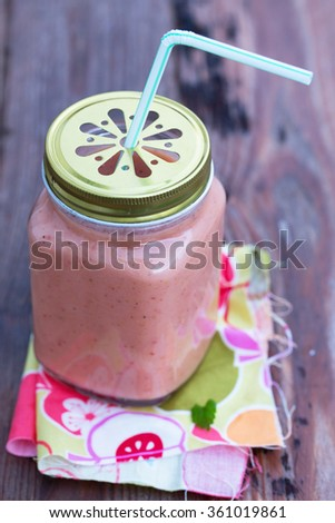 Fresh and organic smoothie (kiwi, mango, banana, strawberry) - perfect vitamin bomb for healthy eating or dieting. Natural light. Selective focus.  - stock photo