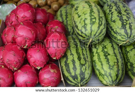 Fresh and Pile of dragon fruit and watermelons other fruits sold in a street market in Taiwan