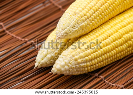 Fresh and raw or uncooked yellow corn grains for food and healthy diet background - stock photo