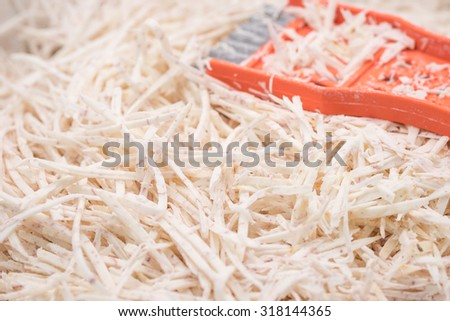 Fresh and raw taro or yam, peeled in pieces for food preparation background - stock photo