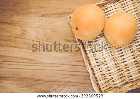 fresh and ripe apricots in a wicker canister - organic food backgrounds