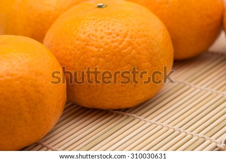 Fresh and ripe oranges on bamboo table for fruit background - stock photo