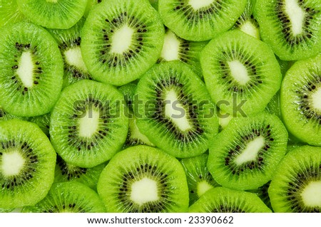 Fresh and ripe slices of kiwi fruit, great summer wallpaper background - stock photo