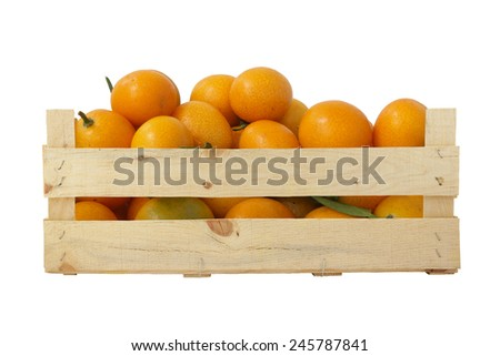 Fresh and ripe tangerines in wooden box isolated  - stock photo