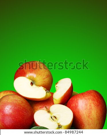 Fresh and tasty apples against green gradient - stock photo