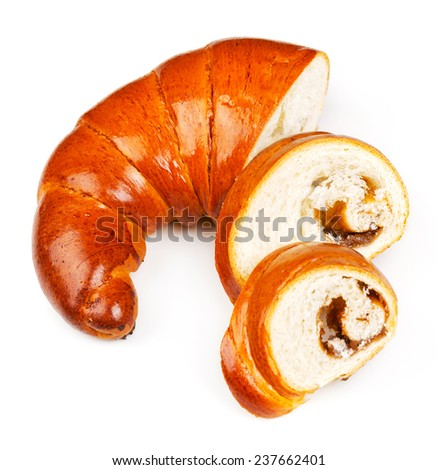 Fresh and tasty bagel with jam sliced pieces over white background - stock photo