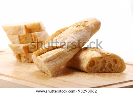 Fresh and tasty bread on the table - stock photo