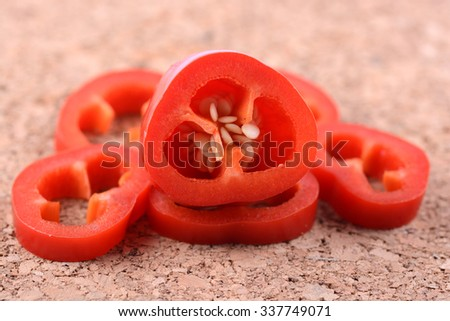 Fresh and tasty bright red capsicum close up with selective focus - stock photo