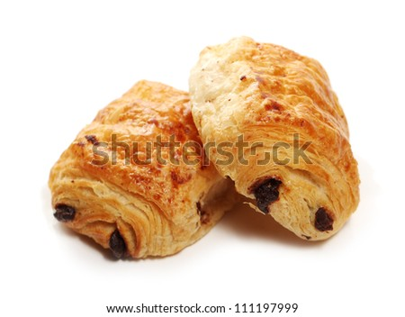 Fresh and tasty buns with raisins over white background