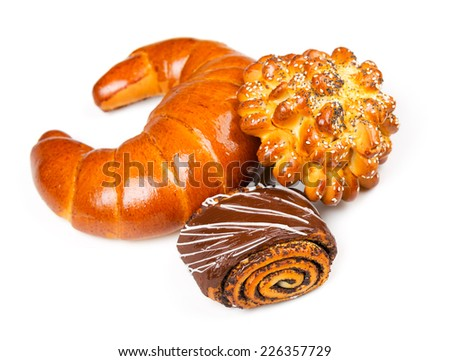 Fresh and tasty buns with with sesame and poppy seeds, bagel with jam and roll with chocolate over white background - stock photo