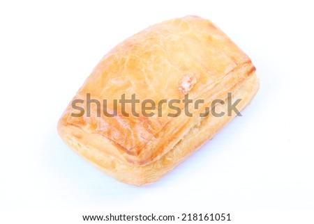 Fresh and tasty croissant on white background - stock photo