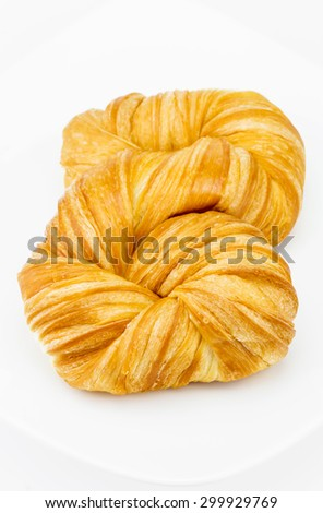 Fresh and tasty croissant on white background