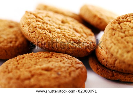 Fresh and tasty oat biscuits on white background