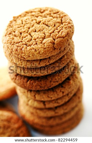 Fresh and tasty oat biscuits on white background - stock photo