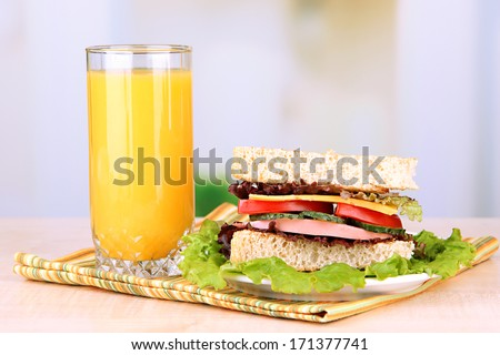 Fresh and tasty sandwich on plate on table on light background - stock photo