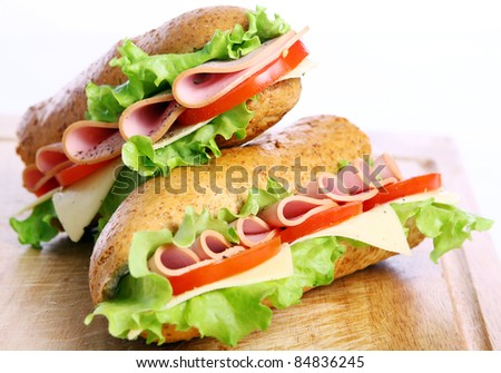 Fresh and tasty sandwich over white background - stock photo
