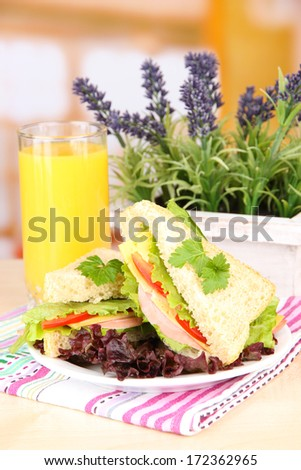 Fresh and tasty sandwiches on plate on table on light background