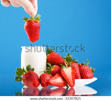 Fresh and tasty strawberries and yogurt - stock photo