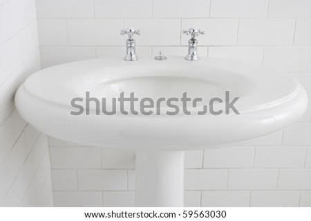 Fresh and vintage washbasin and chrome tap - stock photo