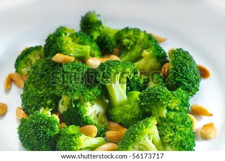 fresh and vivid sauteed broccoli and almonds very ealthy food - stock photo