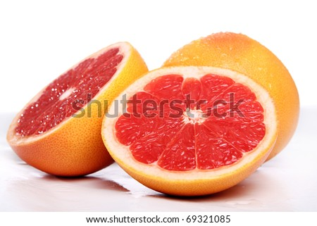 Fresh and wet grapefruit - stock photo