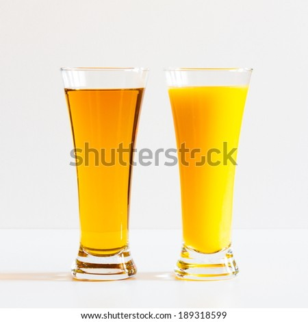 fresh appetizing  and tasty apple  and  orange  juice